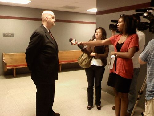 John Mark Byers talks with reporters